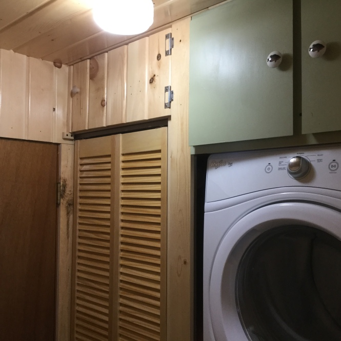 This bifold closet hides household trash and the vacuum. The space above is for off season items.